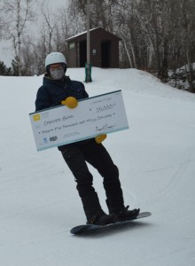 Skiing with check donation.